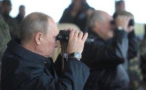 Putin watching with spyglass