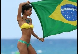 Brazilian woman with a Brazilian flag