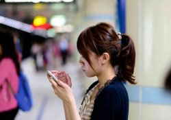 Japanese girl texting on her phone