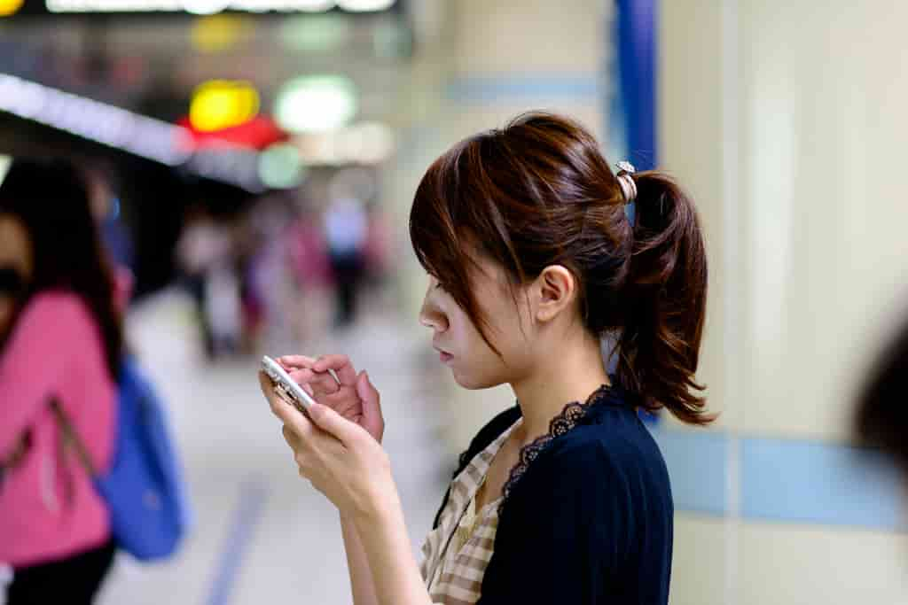 Japanese girl looking at her phone