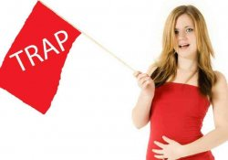 "woman holding red flag that says ""Trap""."